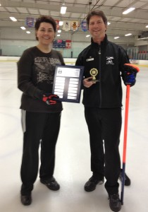 Francesca Somma presents Mark Dossett with the 2011 Curl San Diego Member of the Year Award.